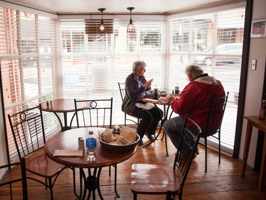 Susanna Williams, left, and Gary Campbell, eat lunch