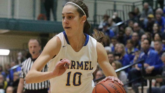 Carmel's #10 Amy Dilk drives for the hoop during the