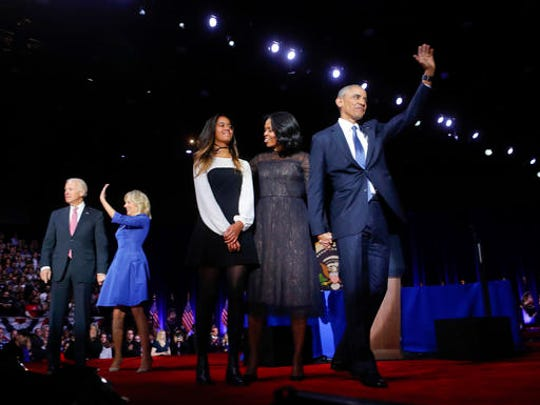 President Barack Obama on stage with first lady Michelle Obama, daughter Malia, Vice President Joe Biden and his wife Jill Biden after his farewell address at McCormick Place in Chicago, Tuesday, Jan. 10, 2017.