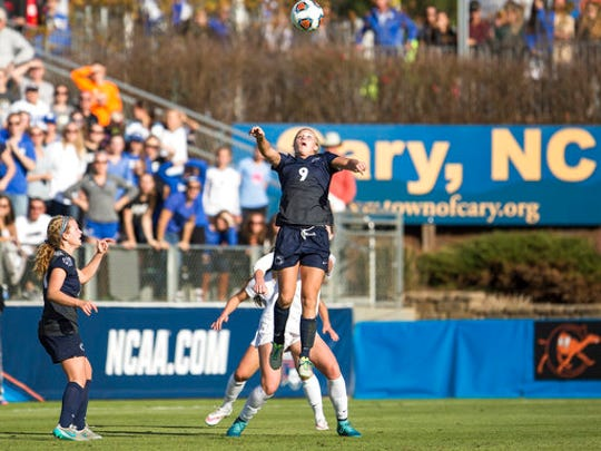 "FILE - In this Dec. 6, 2015, file photo, Penn State's Frannie Crouse (9) jumps for a header as teammate Emily Ogle, left, watches during the NCAA Women's College Cup soccer final against Duke in Cary, N.C.  The NCAA says it will consider North Carolina as a host for championship events again after the state rolled back a law that limited protections for LGBT people. In a statement Tuesday, April 4, 2017, the governing body said its Board of Governors had reviewed moves to repeal repealed the so-called ""bathroom bill"" and replace it with a compromise law."