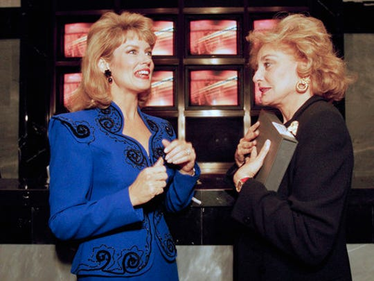 "FILE - In this Sept. 28, 1994 file photo, ""Entertainment Tonight"" co-host Mary Hart, left, talks with Barbara Walters during a reception at the Museum of Television and Radio in New York. Hart's legacy in entertainment news will be recognized Sunday, April 30, 2017 with a lifetime achievement award at the Daytime Emmys ceremony."