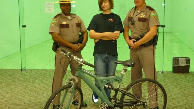 A Sioux Falls South Daktoa Highway Patrol squad pooled together their resources to donate a bike to a young man who was walking 8 miles to and from work every day.