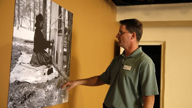 Farmington Museum Director Bart Wilsey talks about a picture on the wall of the future Native American art and culture museum on Thursday at 301 W. Main St. in Farmington.