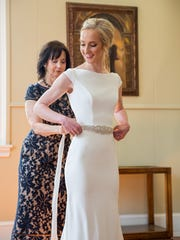Kay Michot helps her daughter Katharine with her wedding
