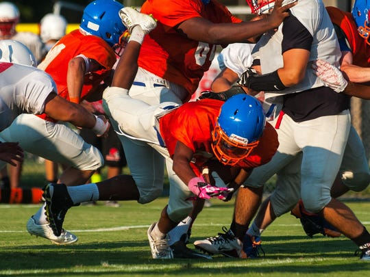 Delmar's Ziggy Ryder fights into the end zone against James M. Bennett at Delmar during a preseason scrimmage.