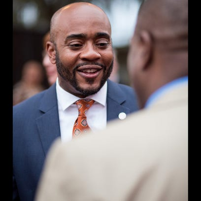 Rep. Alan Williams chats at a party hosted by Associated
