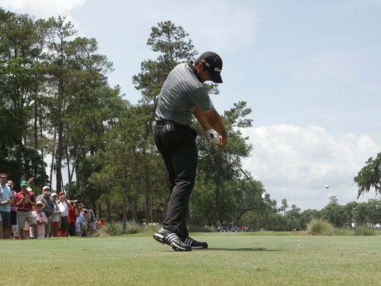 Jason Day, of Australia, tees off on the ninth hole during a practice round for The Players Championship golf tournament,  Wednesday, May 11, 2016, in Ponte Vedra Beach, Fla. (AP Photo/Lynne Sladky)