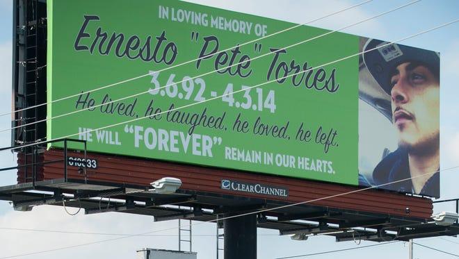 Billboard on Admiral Wilson Boulevard in Pennsauken serves as memorial to Ernesto 'Pete' Torres of Camden, who was slain in April 2014.