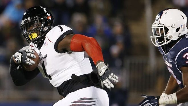 Jeff Luc, shown here returning a fumble against UConn, led UC with 134 tackles this season.