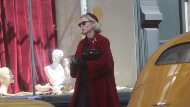"""Oscar-winning actress Cate Blanchett walks down Fourth Street during the filming of the movie """"Carol"""" on the corner of Fourth Street and Central Avenue in downtown Cincinnati in 2014. The film received about $3 million in tax credits."""