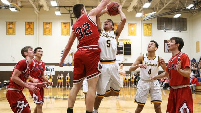 Cameron Davis (5) and the Kickapoo Chiefs have the No. 1 seed in the Blue Division of the 70th Greenwood Blue and Gold basketball tournament.
