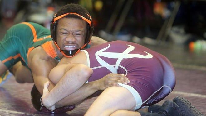 Trey Wardlaw of East Ramapo defeated Ulises Olmedo of Arlington in a 113 pound match during the semifinals of the Section 1 dual meeting wrestling championships at John Jay High School Dec. 15, 2015. Both will compete in the Eastern States Classic at Sullivan Community College this weekend.