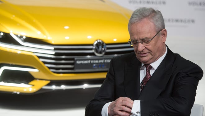 In this March 12 picture Volkswagen CEO, Martin Winterkorn, looks at his watch during the annual press conference of Volkswagen AG in Berlin. Volkswagen CEO Martin Winterkorn said Sept. 23 he is stepping down.