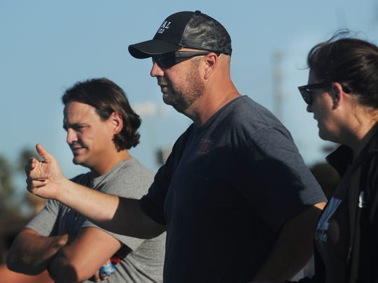 Devin Hurst, center, head coach of the Royal High School girls water polo team and father of star player Sydney Hurst, is flanked by assistant coaches Ramiro Saldain and Joyce Abarta during a recent practice.
