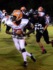 KENNETH CUMMINGS/The Jackson SunSouth Gibson's Dre McAlister looks for open room to run during Friday night's game against South Side during their game in Jackson last year.