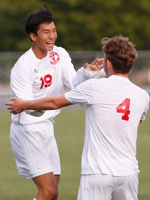 West Lafayette's Alex Lee, left, celebrates with Evan Chapple after his goal at 5:20 in the first half put the Red Devils up 2-1 over Rensselaer in the Hoosier Conference boys soccer tournament Thursday, September 7, 2017, in West Lafayette. West Lafayette defeated Rensselaer 6-2.