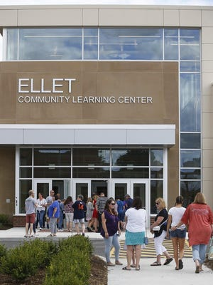 Students and alumni walk into the new Ellet Community Learning Center for an open house Saturday in Akron.