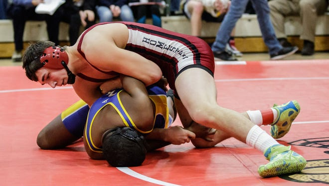 Homestead wrestler Jacob Zupke (top) grapples with Milwaukee King wrestler Jayden Smith during the WIAA D1 sectional at Homestead on Saturday, Feb. 17, 2018.