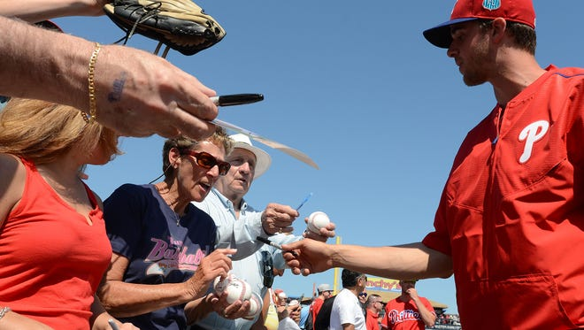 Phillies starting pitcher Aaron Nola signs autographs before the start of the spring training game Tuesday against the Toronto Blue Jays at Bright House Field.