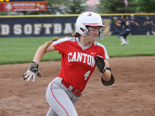 Izzy Dawson rounds third base while scoring Canton's