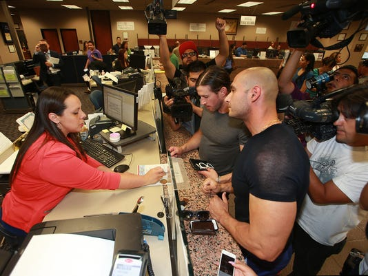 """""""VICTOR CALZADA-EL PASO TIMES El Paso County Clerk Vitals Department Supervisor Diannia (CQ) A. Leyva assisted Yairo Herrera, right, and Luke Oleander as they applied for a marriage license Friday at the El Paso County Courthouse. """""""