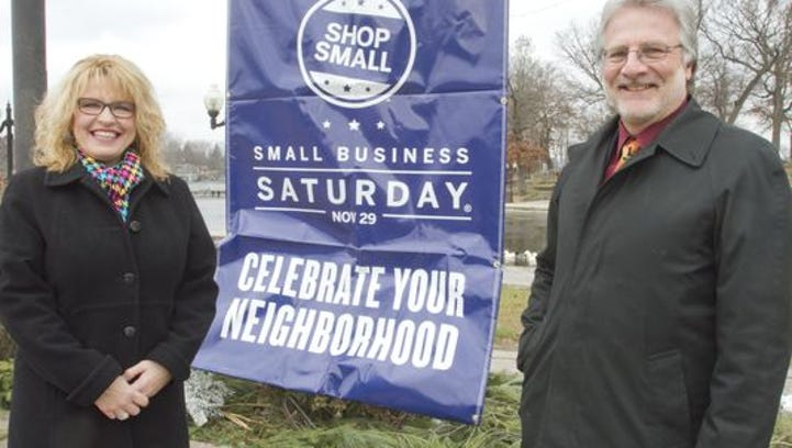 Barb and Mark Binkley of Cooper & Binkley Jewelers promote Small Business Saturday last year.