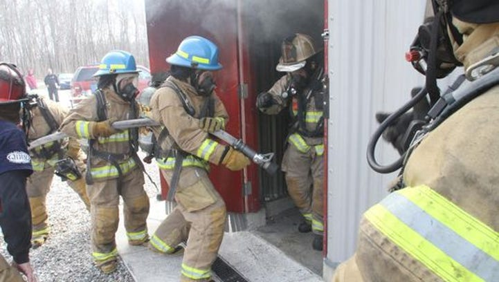 Howell High School Fire Academy cadets practice their