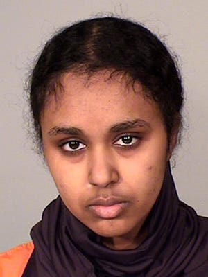 This file photo provided by the Ramsey County Sheriff's Office in St. Paul, Minn., shows Tnuza Jamal Hassan, of Minnesota. Hassan, who authorities say had hoped to kill people when she set fires in January 2018 on a college campus, has been ordered detained by a federal judge. Hassan pleaded not guilty Monday, Feb. 12, 2018, to federal counts of attempting to provide material support to al-Qaida, lying to the FBI and arson. (Ramsey County Sheriff's Office via AP, File)