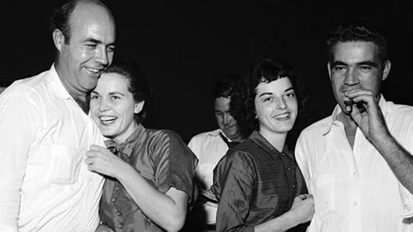 J.W. and Juanita Milam and Carolyn and Roy Bryant celebrate after the men's acquittals in the 1955 murder of Emmett Till. Months later, they confessed their guilt to Look magazine.