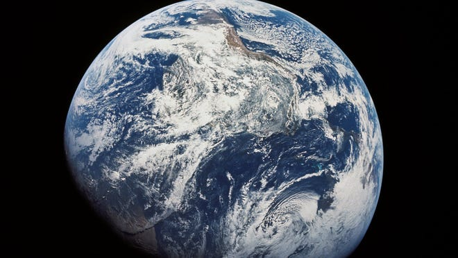 The first image taken by humans of the whole Earth. Photographed by the crew of Apollo 8 (probably by Bill Anders) the photo shows the Earth at a distance of about 30,000 km. South is at the top, with South America visible at the covering the top half center, with Africa entering into shadow. North America is in the bottom right.