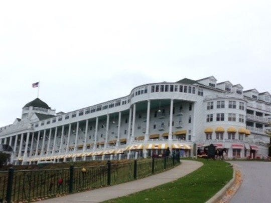 As horse drawn carriages approach the historic Grand Hotel this is the sight visitors see. There are 390 rooms, each decorated in a unique way. The grounds are beautiful and the longest porch in the world has rocking chairs for relaxing.