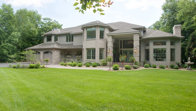 Nestled on the banks of the Mississippi River, 4067 Pine Point Road in Sartell is listed at $1.699 million.