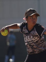 Quincee Lilio gets ready to throw the ball from second base in this picture during a softball camp. Quincee Lilio is the granddaughter of Eddie Aguon, a former Guam Major League player.