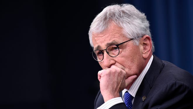 Defense Secretary Chuck Hagel listens to a question during an Oct. 20, 2014, briefing at the Pentagon.