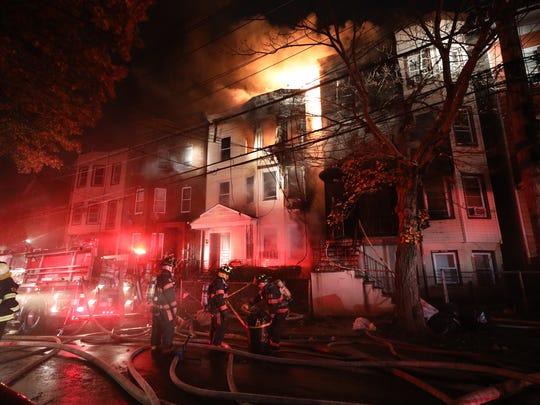 Yonkers firefighters battle a 4-alarm blaze on Oak Street in the city.