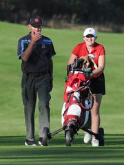 Arrowhead coach Mike Breaker (left) and Emily Lauterbach