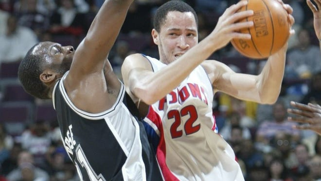 Pistons' Tayshaun Prince drives against Spurs' Malik Rose at the Palace in 2003.