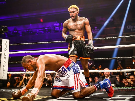 Jarrett Hurd stands over Erislandy Lara after his 12th-round knockdown of the champion.