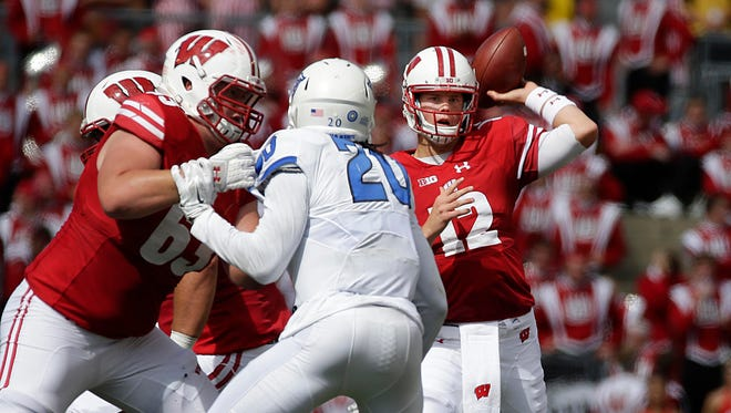 Wisconsin Badgers quarterback Alex Hornibrook (12) was 8-12 with 122 yards and 1 touchdown during Wisconsin's 23-17 win over Georgia State  during the NCAA football  game Saturday, September 17, 2016, at Camp Randall Stadium in Madison, Wis. Milwaukee Journal Sentinel photo by Rick Wood/RWOOD@JOURNALSENTINEL.COM ORG XMIT: 00089497A