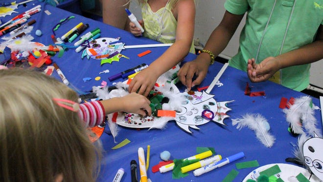 Students entering grades 1 and 2 create colorful fish in one of the Playhouse in the Park's rehearsal halls. More than two dozen theater professionals work as instructors at the Playhouse's summer camp for students in grades 1-12, which runs through July 31.