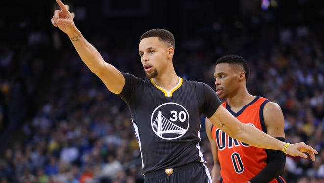 Feb 6, 2016; Oakland, CA, USA; Golden State Warriors guard Stephen Curry (30) gestures from the court against the Oklahoma City Thunder in the fourth quarter at Oracle Arena. The Warriors won 116-108. Mandatory Credit: Cary Edmondson-USA TODAY Sports