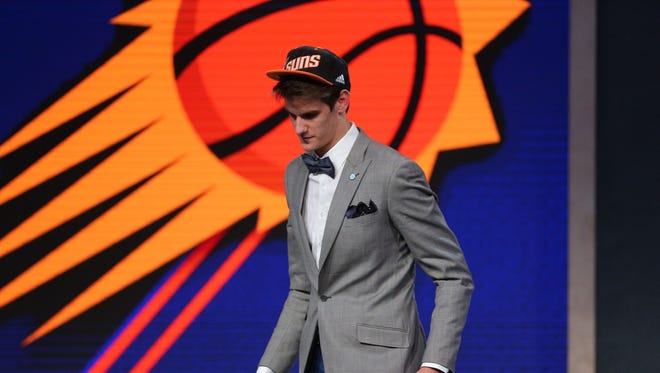 Jun 23, 2016; New York, NY, USA; Dragan Bender walks off the stage after being selected as the number four overall pick to the Phoenix Suns in the first round of the 2016 NBA Draft at Barclays Center.