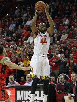 Maryland guard Dez Wells shoots the ball against Rutgers at Xfinity Center.