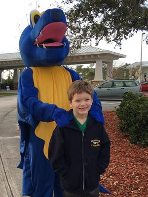 Alexander Wall of Viera with the Space Coast Runners dragon, mascot of the upcoming Eye of the Dragon 10K.