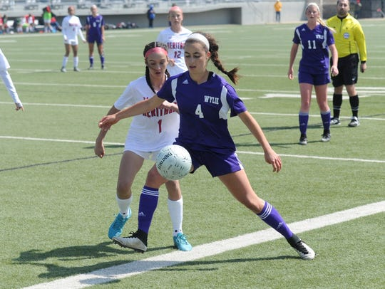 Wylie midfielder Gracie McCaslin (4) protects the ball