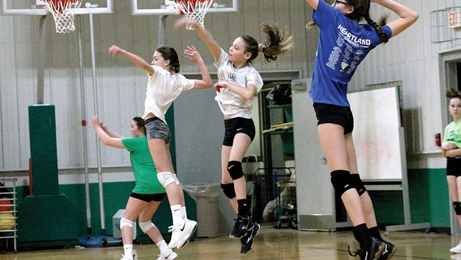 Members of the Wethersfield Junior High girls volleyball team practice on March 19, 2019. The Illinois Elementary School Association released a modified schedule that will permit play starting in January. Last season, the girls volleyball postseason was canceled because of the coronavirus pandemic.