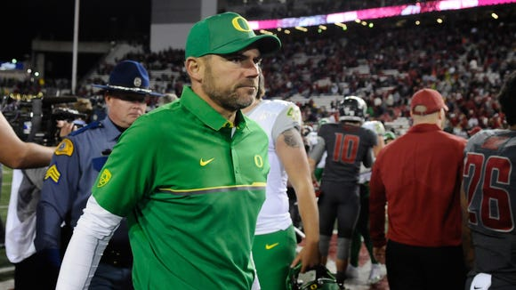Oct 1, 2016; Pullman, WA, USA; Oregon Ducks head coach Mark Helfrich walks off the field after a game against the Washington State Cougars at Martin Stadium. The Cougars won 51-33. Mandatory Credit: James Snook-USA TODAY Sports