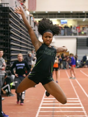 "Rush-Henrietta's Lanae-Tava Thomas jumps  20' 2.5"" for a Section V record during the Class A and B Sectional finals."
