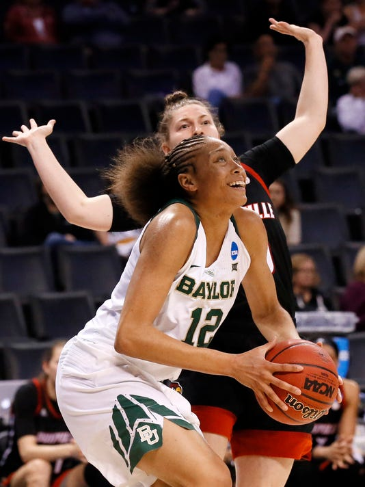 Baylor guard Alexis Prince (12) moves to the basket for a shot attempt past Louisville guard Sydney Zambrotta, rear, during the first half of a regional semifinal of the NCAA women's college basketball tournament, Friday, March 24, 2017, in Oklahoma City. (AP Photo/Sue Ogrocki)