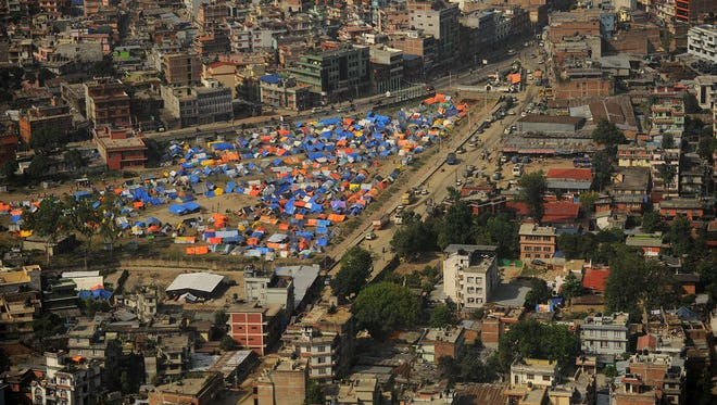 This aerial view taken from a Nepal army military helicopter shows a relief camp for earthquake survivors in Kathmandu.
